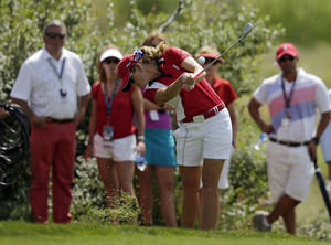 Photo - United States' Paula Creamer hits from the rough on the eighth hole during her singles match against Europe's Charley Hull, from England, at the Solheim Cup golf tournament Sunday, Aug. 18, 2013, in Parker, Colo. Hull won the match 5-4. (AP Photo/Chris Carlson)