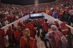 Photo - Fans file out of the stadium during a storm delay before the start of the college football game between the University of Oklahoma Sooners (OU) and Texas Tech University Red Raiders (TTU) at the Gaylord Family-Oklahoma Memorial Stadium on Saturday, Oct. 22, 2011. in Norman, Okla. Photo by Chris Landsberger, The Oklahoman