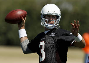Photo - New Arizona Cardinals quarterback Carson Palmer throws the ball during a voluntary Cardinals football mini camp, on Tuesday, April 23, 2013, in Tempe, Ariz. (AP Photo/Ross D. Franklin)