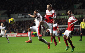 Photo - Fulham's Dimitar Berbatov, right, and Swansea City's Ashley Williams battle for the ball during their English Premier League soccer match at the Liberty Stadium, Swansea, Wales, Tuesday, Jan. 28, 2014. (AP Photo/Nick Potts, PA Wire)   UNITED KINGDOM OUT  -  NO SALES  -  NO ARCHIVES