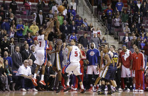 photo - Detroit Pistons guard Brandon Knight (7), defended by Utah Jazz forward DeMarre Carroll, shoots a 3-pointer during the closing seconds during the second half of an NBA basketball game at the Palace of Auburn Hills, Mich., Saturday, Jan. 12, 2013. Knight missed the shot that would have tied the game. The Jazz won 90-87.(AP Photo/Carlos Osorio)