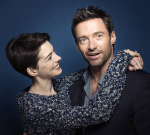 "Photo - This Dec. 2, 2012 photo shows actors Anne Hathaway, left, and Hugh Jackman in New York. Hathaway portrays Fantine and Jackman portrays Jean Valjean in the film adaptation of the Victor Hugo novel, ""Les Miserables."" The film opens on Christmas Day. (Photo by Victoria Will/Invision/AP)"