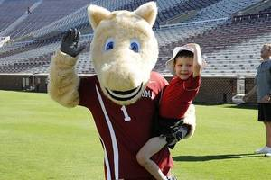 Photo - Javi Restrepo poses with one of the OU mascots during the multi-sport morning the OU athletic department organized for him. (Photo provided)