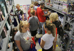 Photo - Oklahoma City metro-area teachers pick out school supplies Thursday as Feed the Children opens its new Teachers Store at its headquarters in Oklahoma City. Photo by Paul Hellstern, The Oklahoman <strong>PAUL HELLSTERN</strong>