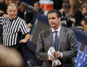 Photo - Kentucky coach John Calipari reacts to a call during the first half of an NCAA college basketball game against Notre Dame on Thursday, Nov. 29, 2012, in South Bend, Ind. (AP Photo/Joe Raymond)
