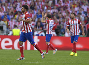 Photo - Atletico's Diego Costa runs, during the Champions League final soccer match between Atletico Madrid and Real Madrid, at the Luz stadium, in Lisbon, Portugal, Saturday, May 24, 2014. (AP Photo/Manu Fernandez)