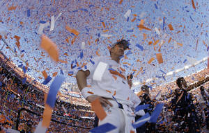 Photo - Denver Broncos quarterback Peyton Manning is engulfed in confetti during the trophy ceremony after the AFC Championship NFL playoff football game in Denver, Sunday, Jan. 19, 2014. The Broncos defeated the Patriots 26-16 to advance to the Super Bowl. (AP Photo/Charlie Riedel)