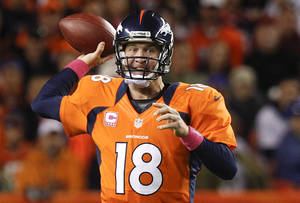 Photo -   Denver Broncos quarterback Peyton Manning (18) throws against the New Orleans Saints in the first quarter of an NFL football game, Sunday, Oct. 28, 2012, in Denver. (AP Photo/David Zalubowski)