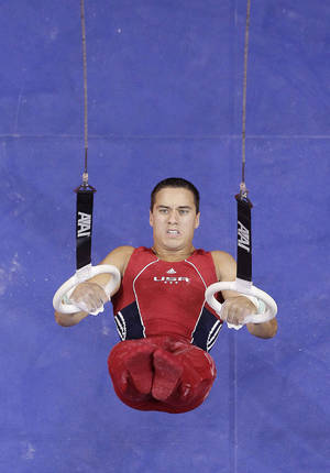 Photo - OU's Jake Dalton competes on the still rings during the U.S. gymnastics trials on Saturday in San Jose, Calif. Dalton is in the running for one of three remaining spots on the U.S. Olympic team, which will be announced Sunday. AP Photo