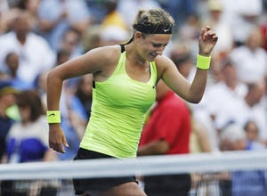 Photo -   Victoria Azarenka, of Belarus, reacts after winning her match against Maria Sharapova, of Russia, during a semifinal match at the 2012 US Open tennis tournament, Friday, Sept. 7, 2012, in New York. (AP Photo/Darron Cummings)