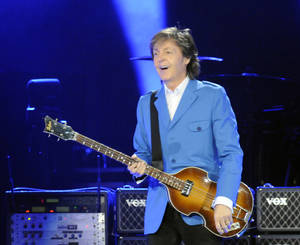 "Photo - Sir Paul McCartney performs with his band during the ""Out There"" Tour at the Times Union Center on Saturday, July 5, 2014, in Albany, N.Y. (Photo by Hans Pennink/Invision/AP)"