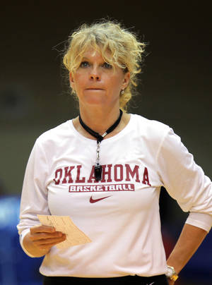 Photo - Oklahoma head women's basketball coach Sherri Coale watches her team practice before the NCAA basketball tournament in Durham, N.C., Friday, March 21, 2014.  Oklahoma faces DePaul in the first round on Saturday.  (AP Photo/Ted Richardson)