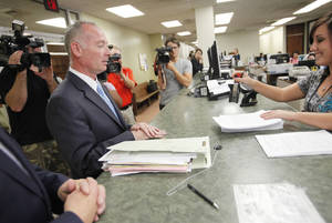 Photo - Defense attorney David Slane files papers to have the age of consent law declared unconstitutional in the District Court Clerk's office in Oklahoma City, Tuesday September  4, 2012. Photo By Steve Gooch, The Oklahoman