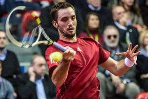 Photo - Serbia's Viktor Troicki returns the ball during the Davis Cup World Group first round match against Belgium's David Goffin at the Spriroudome in Charleroi, Belgium, Friday Feb. 1, 2013. (AP Photo/Geert Vanden Wijngaert)