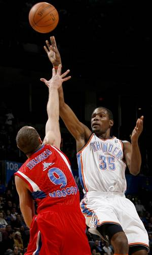 Photo - Oklahoma City's Kevin Durant (35) shoots the ball over CSKA Moscow's Ramunas Siskauskas (9) during the preseason NBA basketball game between the Oklahoma City Thunder and CSKA Moscow in Oklahoma City, Thursday, October 14, 2010. Photo by Bryan Terry, The Oklahoman