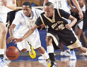 Photo - Putnam City West's Kyndall Dudley, left, and Midwest City's Greg Austin chase a loose ball during a Class 6A semifinal game  Friday. Photo by Nate Billings, The Oklahoman
