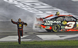 Photo -   Austin Dillon runs to meet his pit crew after winning the NASCAR Nationwide Series auto race at Kentucky Speedway in Sparta, Ky., Friday, June 29, 2012. (AP Photo/Bud Kraft)