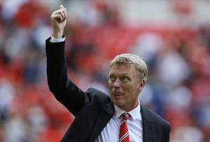 Photo - Manchester United's manager David Moyes reacts to their win against  Wigan Athletic at the end of their English FA Community Shield soccer match at Wembley Stadium in London, Sunday, Aug. 11, 2013. (AP Photo/Kirsty Wigglesworth)