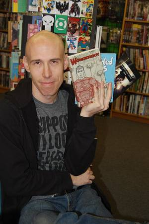 """Photo - Charles Martin holds books from Literati Press including his own """"The Wonderboy Serials"""" Vol. 2.  Photo by Annette Price, for The Oklahoman <strong></strong>"""