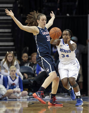 Photo - Memphis guard Devin Mack (34) passes around Connecticut forward Breanna Stewart (30) in the second half of an NCAA college basketball game Saturday, Jan. 4, 2014, in Memphis, Tenn. (AP Photo/Mark Humphrey)