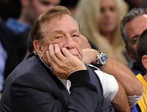 Photo - FILE - In this Feb. 25, 2011, file photo, Los Angeles Clippers owner Donald Sterling looks on during the first half of their NBA basketball game against the Los Angeles Lakers in Los Angeles. Sterling could use lawyers and lawsuits to challenge the NBA's plan to force him out over recent racist comments, but legal experts say the league would likely prevail in the end. Sports law experts say the NBA's constitution gives its Board of Governors broad latitude in league decisions including who owns the teams. NBA Commissioner Adam Silver wants a swift vote against Sterling, which requires a minimum of three-fourths of the other 29 controlling owners to agree. (AP Photo/Mark J. Terrill, File)