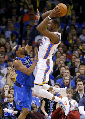 photo - Oklahoma City's Kevin Durant (35) psses the ball over Dallas' Vince Carter (25) during an NBA basketball game between the Oklahoma City Thunder and the Dallas Mavericks at Chesapeake Energy Arena in Oklahoma City, Thursday, Dec. 27, 2012.  Oklahoma City won 111-105. Photo by Bryan Terry, The Oklahoman