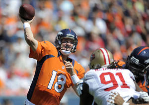 Photo -   FILE - In this Aug. 26, 2012, file photo, Denver Broncos quarterback Peyton Manning (18) passes against the San Francisco 49ers during the first quarter of an NFL preseason football game in Denver. No need to ask Steelers coach Mike Tomlin if Peyton Manning is back. As far as Tomlin is concerned, the Broncos quarterback never left. (AP Photo/Jack Dempsey, File)
