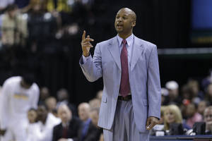 Photo - FILE - Associated head coach Brian Shaw coaches the team after head coach Frank Vogel was ejected in the second half of an NBA basketball game against the Cleveland Cavaliers in Indianapolis, in this April 9, 2013 file photo. Shaw has agreed to succeed George Karl as coach of the Denver Nuggets, a person familiar with the negotiations told The Associated Press Monday June 24, 2013. The Nuggets called a news conference for Tuesday afternoon, where team president Josh Kroenke and newly hired general manager Tim Connelly will introduce their new coach. (AP Photo/Michael Conroy, File)