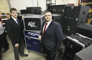 photo - John Cory and Brad Poarch, co-owners of Cory's Audio Visual Services, with cases of audio and lighting equipment. Photo by Paul B. Southerland, The Oklahoman