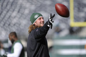 "Photo - ADVANCE FOR WEEKEND EDITIONS, DEC. 14-15 - FILE - In this Dec. 1, 2013 file photo, New York Jets tight end Zach Sudfeld works out before an NFL football game against the Miami Dolphins, in East Rutherford, N.J. Sudfeld could have given up on football a few years ago, just as many people told him to. The metal dog tag he wears under his football pads that he got from his grandfather with the Winston Churchill quote engraved on it epitomizes his journey: ""Never, never give up.""  (AP Photo/Bill Kostroun, File)"