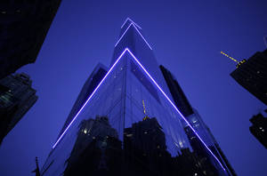 Photo - The 68-story Courtyard-Residence Inn Central Park is illuminated early Wednesday, Jan. 8, 2014, in New York. The Council on Tall Buildings and Urban Habitat in Illinois, which compiles lists of tall buildings, is listing the building as the tallest hotel in North America. (AP Photo/Mark Lennihan)