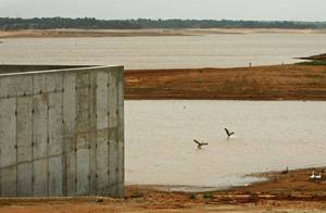 photo - Experts estimate $87 billion in Oklahoma drinking water system improvements will be needed over the next 50 years due to aging systems and growing water needs. This picture is of Lake Stanley Draper, where the water level has been lowered since August while a $46 million renovation project has been underway that includes installing 24 new pumps and renovating six pumping stations. <strong>STEVE SISNEY - THE OKLAHOMAN</strong>