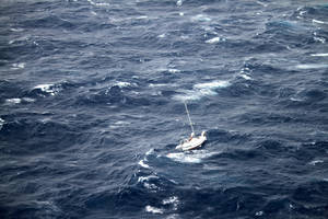 Photo - This Sunday, Aug. 10, 2014 photo provided by the U.S. Coast Guard shows the 42-foot sailboat Walkabout caught in Hurricane Julio, about 400 miles northeast of Oahu, Hawaii. Walkabout is disabled and taking on water with three people aboard. The Coast Guard is coordinating the rescue of the boat. (AP Photo/U.S. Coast Guard)