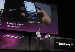 photo - FILE - In this Sept. 25, 2012 file photo, Thorsten Heins, President and CEO of Research in Motion, gestures while talking about the messenger capabilities of the new BlackBerry 10 at the BlackBerry Jam Americas conference in San Jose, Calif.  BlackBerry-maker Research In Motion, which is already struggling with plunging sales, on Thursday, Dec. 20, 2012 said it lost subscribers for the first time in the latest quarter, as the global number of BlackBerry users dipped to 79 million and the stock plunged in after hours after the company said it will change the way it shares revenue with carriers. (AP Photo/Eric Risberg, File)