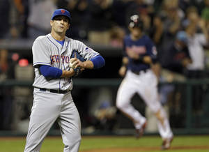 Photo - New York Mets relief pitcher Tim Byrdak reacts after giving up a grand slam to Cleveland Indians' Nick Swisher in the eighth inning of a baseball game Friday, Sept. 6, 2013, in Cleveland. (AP Photo/Mark Duncan)