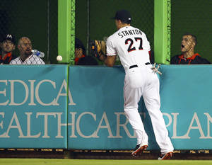 Photo - Miami Marlins' Giancario Stanton misplays a ball hit by Chicago Cubs' Chris Coghlan during the second inning of a baseball game in Miami, Wednesday, June 18, 2014.  (AP Photo/J Pat Carter)