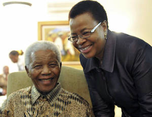 photo - FILE  This May 16, 2011 file photo supplied by the South African Government Communications and Information Services, GCIS, shows former South African President Nelson Mandela and his wife Graca Machel after they cast an early ballot in upcoming local elections at his home in Johannesburg, South Africa. South Africa's president has visited former leader Nelson Mandela in a hospital, and the presidency says Mandela continues to respond to treatment. The office of President Jacob Zuma says he saw Mandela on Saturday, Dec. 22, 2012,  in Pretoria, the capital, and assured the anti-apartheid icon that he has the support of all South Africans and the world. Mandela, who is 94, has been hospitalized since Dec. 8. He was diagnosed with a lung infection and also had gallstone surgery. (AP Photo/Elmond Jiyane-GCIS, File)