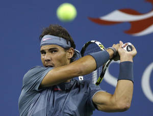 Photo - Rafael Nadal, of Spain, returns a shot to countryman Tommy Robredo during the quarterfinals of the U.S. Open tennis tournament, on Wednesday, Sept. 4, 2013, in New York. (AP Photo/Mike Groll)