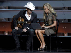 Photo - Co-hosts Brad Paisley and Carrie Underwood perform a skit during the opening of the 47th annual CMA Awards on Wednesday at Bridgestone Arena in Nashville, Tenn. AP photo