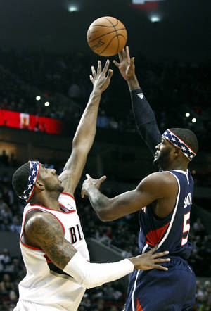 photo -   Atlanta Hawks forward Josh Smith, right, shoots over Portland Trail Blazers forward LaMarcus Aldridge during the first half of their NBA basketball game in Portland, Ore., Monday, Nov. 12, 2012. (AP Photo/Don Ryan)