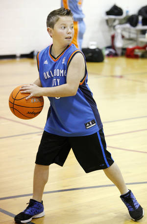 Photo - Dillon Smith, 11, looks to pass the ball during March Madness basketball camp at the YMCA in Bethany. Photo by Paul B. Southerland, The Oklahoman <strong>PAUL B. SOUTHERLAND - PAUL B. SOUTHERLAND</strong>