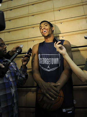 photo - Georgetown's Hollis Thompson laughs as he talks to reporters during their NCAA college basketball media day on Thursday, Oct. 13, 2011, in Washington. (AP Photo/Nick Wass)