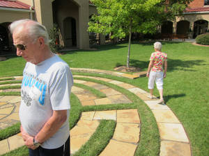 "Photo - Malcolm and Kathy May, of Bethany, members of St. Paul's Episcopal Cathedral, walk the labyrinth in the church's east garden during ""The Day of the Labyrinth"" event held recently at St. Paul's, 127 NW 7. PHOTO BY CARLA HINTON, THE OKLAHOMAN <strong>Carla Hinton - The Oklahoman</strong>"