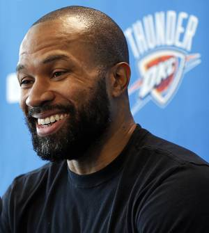 Photo - Derek Fisher laughs during exit interviews with the media for the Oklahoma City Thunder at the team's practice facility in Oklahoma City, Sunday, June 1, 2014. PHOTO BY NATE BILLINGS, The Oklahoman