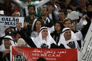 Photo - Brazil's Atletico Mineiro fans cheer players during the semi final soccer match between Morocco's Raja Casablanca and Atletico Mineiro at the Club World Cup soccer tournament in Marrakech, Morocco, Wednesday, Dec. 18, 2013. (AP Photo/Christophe Ena)