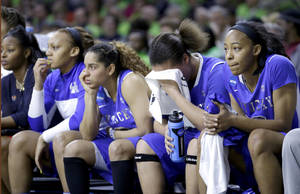 Photo - Kentucky players react as they watch from the banch during the second half of a regional semifinal in the NCAA college basketball tournament against Baylor at the Purcell Pavilion in South Bend, Ind., Saturday, March 29, 2014. Baylor won 90-72. (AP Photo/Nam Y. Huh)
