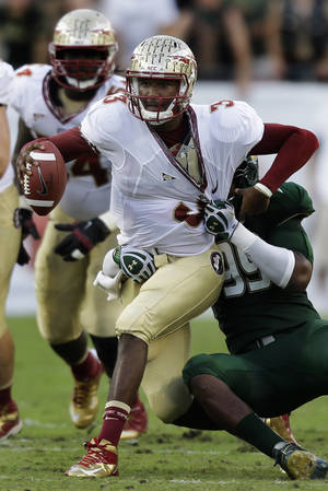 Photo -   Florida State quarterback EJ Manuel (3) gets sacked by South Florida defensive lineman Tevin Mims (99) during the first quarter of an NCAA college football game Saturday, Sept. 29, 2012, in Tampa, Fla. (AP Photo/Chris O'Meara)