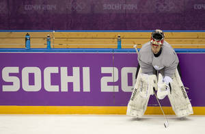 Photo - Team Canada goalie Roberto Luongo watches a drill during practice at the Sochi Winter Olympics Tuesday, Feb. 11, 2014, in Sochi, Russia. (AP Photo/The Canadian Press, Adrian Wyld)