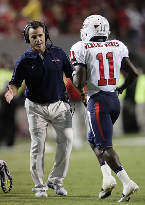 photo -   South Alabama coach Joey Jones congratulates Jereme Jones (11) following Jones' touchdown against North Carolina State during the second half of an NCAA college football game in Raleigh, N.C., Saturday, Sept. 15, 2012. North Carolina State won 31-7. (AP Photo/Gerry Broome)
