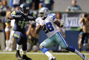 Photo -   Dallas Cowboys' Felix Jones (28) rushes as Seattle Seahawks' Byron Maxwell defends in the first half of an NFL football game on Sunday, Sept. 16, 2012, in Seattle. (AP Photo/John Froschauer)